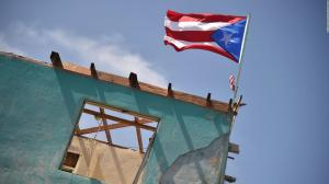 171004164139-getty-puerto-rico-flag-house-brought-down-by-hurricane-full-169_0