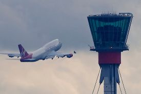 800px-London_Heathrow_tower_and_Virgin_B747_(5048342074)_(2)