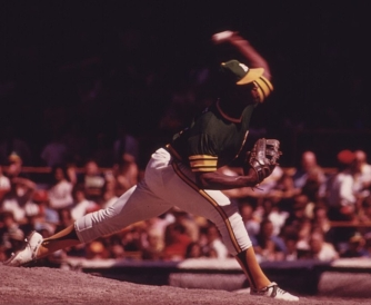 1280px-An_Oakland_A's_Pitcher_Delivers_During_A_Game_With_The_Home_Team_Chicago_Cubs_At_Wrigley_Field,_07-1973_(8674830191)