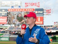 NASA astronaut Kjell Lindgren is interviewed before he throws out the ceremonial first pitch at the Washington Nationals versus Philadelphia Phillies game at Nationals Park in Washington, DC on Tuesday, April 26, 2016. Lindgren spent 141 days aboard the International Space Station from July 2015 to December 2015 as part of Expeditions 44 and 45, and conducted two spacewalks during that time. Photo Credit: (NASA/Aubrey Gemignani)