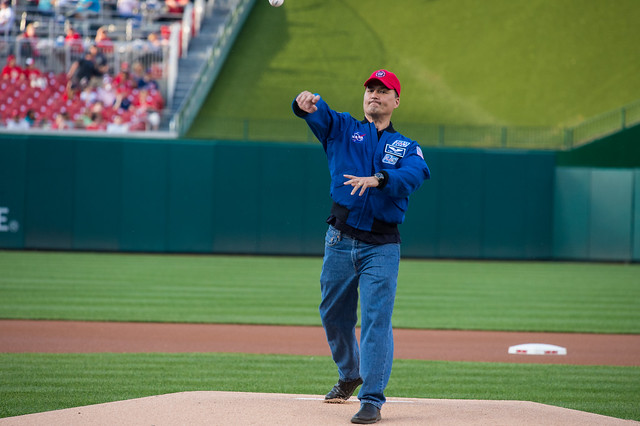 NASA astronaut Kjell Lindgren throws out the ceremonial first pitch before the Washington Nationals take on the Philadelphia Phillies at Nationals Park in Washington, DC on Tuesday, April 26, 2016. Lindgren spent 141 days aboard the International Space Station from July 2015 to December 2015 as part of Expeditions 44 and 45, and conducted two spacewalks during that time. Photo Credit: (NASA/Aubrey Gemignani)