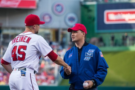 NASA astronaut Kjell Lindgren shakes hands with Blake Treinen, Relief Pitcher for the Washington Nationals after Lindgren threw out the ceremonial first pitch at the Washington Nationals versus Philadelphia Phillies game at Nationals Park in Washington, DC on Tuesday, April 26, 2016. Lindgren spent 141 days aboard the International Space Station from July 2015 to December 2015 as part of Expeditions 44 and 45, and conducted two spacewalks during that time. Photo Credit: (NASA/Aubrey Gemignani)